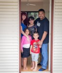 The Willis family at their newly constructed home.