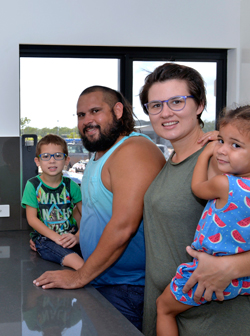 Edward and Sophie with their two children in the kitchen of their new home