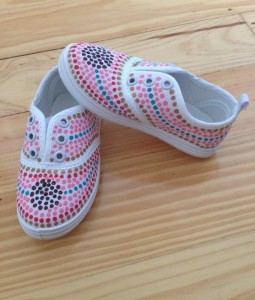 A pair of baby shoes designed by Kylie-Lee Bradford for Kakadu Tiny Tots.